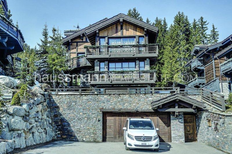 in the prestigious ski resort area of couchevel 1850, beautiful all services chalet